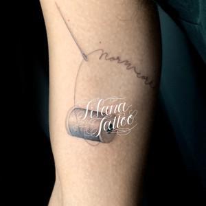 裁縫のタトゥー