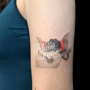 楽器を奏でる天使のタトゥー