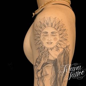 太陽と女神のタトゥー